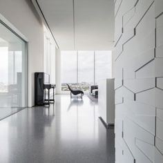 Geometric panels create textured walls inside  monochrome penthouse by Pitsou Kedem