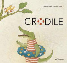 Crodile avait faim, mais sa maman crocodile devait surveiller le nid. Dans le nid, il y avait un oeuf et dans l'oeuf... un petit frère. Crodile partit à la chasse tout seul, mais il était encore petit et n'avait pas l'habitude de chercher seul son goûter. (5-7 años / 5-7 urte)