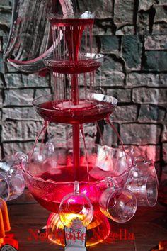 Blood Punch ~  2 parts cranberry juice, 2 parts dark grape juice, 1 part vodka