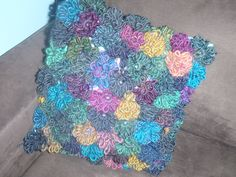 Pillow, flowers made by using the 'Susie flower loom' spotlight.