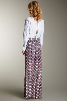 Love the style, except for the lopsided hem.  Don't care for the pattern.