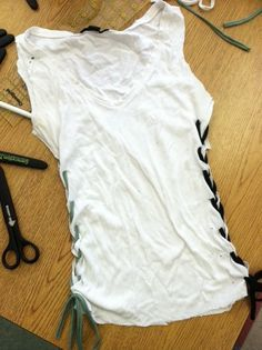 DIY Tee! Cut into a tank nd laced together on the sides! Easy to do sexy shirt! :)