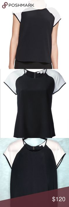 """Authentic Diane von Furstenberg Liva Top Gorgeous color block zip top. It's in great condition except for the 3 small stains on the side of the shirt as you can see in the last photo. There are 3 small dark stains and 1 small white stain that is a little more noticeable.   Estimated Measurements: * Pit to Pit - 19"""" * Length - 25""""  🐾 Pet Friendly Home Diane Von Furstenberg Tops Blouses"""