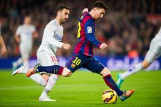 Lionel Messi of FC Barcelona shoots during the La Liga match between FC Barcelona and Club Atletico de Madrid at Camp Nou on January 11, 2015 in Barcelona, Catalonia.