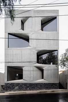 DL1310 is a minimal apartment building located in Mexico City, Mexico, designed by Young & Ayata in collaboration with Michan Architecture. This project is for a mid-market residential building in Mexico City, consisting of seven 1-2 bedroom apartments with parking in the basement. It was decided early on that the construction system would be cast-place-concrete, that the unit types would be simple and straight forward, and that the building would maximize its site footprint and allowed height.
