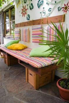 Recycled garden sofa - really like the idea of hanging the pillows behind