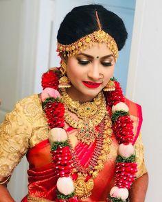 South Indian bride. Gold Indian bridal jewelry.Temple jewelry. Jhumkis.Red silk kanchipuram sari with contrast gold blouse.Braid with fresh jasmine flowers. Tamil bride. Telugu bride. Kannada bride. Hindu bride. Malayalee bride.Kerala bride.South Indian wedding. Pinterest: @deepa8