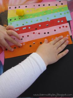 Learn with Play at home: Hole Punch Art for kids.