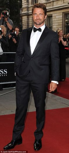 Suits you sir: Gerard Butler and David Gandy lead the dapper gents arriving at the GQ Awar...