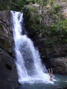 Puerto Rico has many beautiful waterfalls such as this one located in El Yunque, a spectacular rain forest.