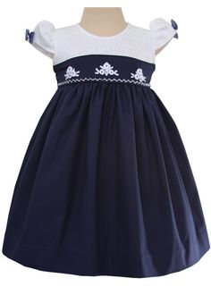 Elegant Lisa Smocked Girls Christmas Dress in Navy and White – Carousel Wear