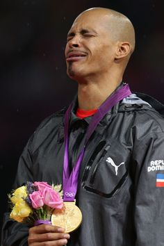 LONDON, ENGLAND - AUGUST 06: Gold medalist Felix Sanchez of Dominican Republic reacts on the podium during the medal ceremony for the Men's 400m Hurdles final on Day 10 of the London 2012 Olympic Games at the Olympic Stadium on August 6, 2012 in London, England. (Photo by Hannah Johnston/Getty Images)