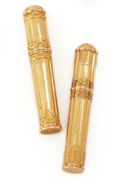 Two Louis XV gold etuis,the first partly-fluted and chased with laurel garlands and entrelac, the base engraved with two coats of arms under a coronet; the second of two-color gold, chased with Vitruvian scrolls, panels of bright-cut borders.  Nicolas Durier, Paris, 1776 and circa 1770. -- Sotheby's