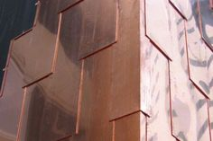 Copper shingles used as cladding on this Project by Arc Roofing, Australia