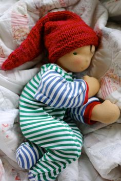 Thorpe wearing his stocking cap. Thorpe is a baby-style natural Waldorf doll by Fig and Me.