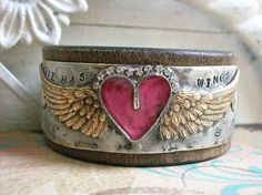 THIS LISTING IS RESERVED FOR SHELLEY.  A little cowgirl glam goes a long way on my Love Has Wings leather cuff bracelets! Each one features my