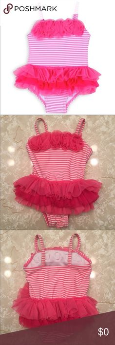 👑 Striped Tutu Swimsuit Capture your baby girl's first splashes in a tutu-cute swimsuit.  * 82% Nylon, 18% Spandex * Machine washable ,tumble dry low * Crafted in quick-dry fabric with UPF 50+. Little Me Swim One Piece