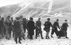 SEP 12 1943 Mussolini is rescued in daring Fallschirmjäger raid Mussolini is escorted by the rescue party.