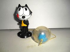 Vintage Felix the Cat hard plastic-attached ball-Baby toy. TM Felix the cat pro.