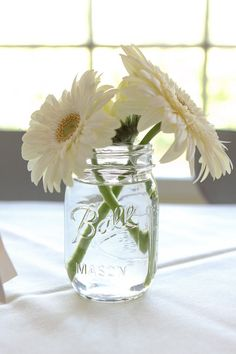 Reception center pieces. Could paint the inside of the jar one of your colors and the flowers could be your other color (or colors).