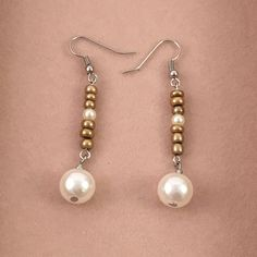 These earrings are made with gold opaque seed beads, and ivory faux pearls. Length: 1.5 inches Our jewelry can be worn for everyday use (shopping, going out with friends, family, or attending a party)