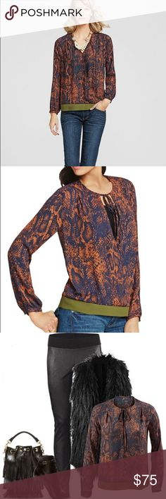 "NWT CAbi Long Sleeve Animal Pattern V-Neck Blouse A rust orange and olive green snakeskin blouse that is eye catching and comfortable with a relaxed fit. An artful wrap shape to flatter the any figure, snap button chest closure and banded bottom. Length 23"" Pit to Pit 18""  100% polyester Open To Offers! CAbi Border Wrap CAbi Tops Blouses"