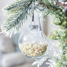 Craft quick, trendy Christmas ornaments using plastic ornaments and elegant pearls.