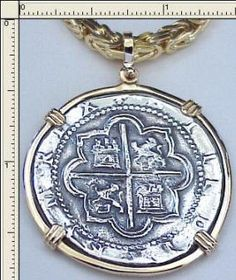#5-1537  Replica Eight Reale Pendant  Rare Lima Mint Coin  14K Solid Gold Bezel  Atocha Silver Coin      $700.00      Chain Not Included