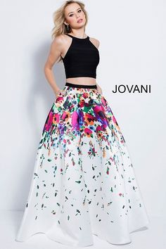 Paint the town in Jovani 58979. This imaginative two-piece ball gown includes a jersey top with a high neckline, and triangular cutout on the back. The top pairs perfectly with the  A-line mikado skirt, which has a vibrant floral print, and side pockets. Make lasting memories in this two-piece gown at a birthday celebration, prom, or pageant.
