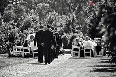 Grooms men making their way down the aisle in the Lower Garden at Brantwyn Mansion Photo Credit: www.jennchildress.com  www.DupontCountryClub.com/weddings