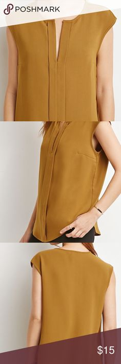 """Keyhole neck top BRAND NEW! Olive/mustard color blouse. Easy and elegant, this sleeveless top will take you from the boardroom to happy hour with ease. It's cut from a light woven fabric and features an inverted pleat in the front with a keyhole neck. Tuck this billowy number into a pencil skirt for work then throw on some statement jewelry for night. Unlined, woven 26"""" full length, 38"""" chest, 38"""" waist Measured from Small Forever 21 Tops Blouses"""