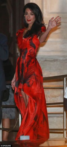 Amal Alamuddin looked glamorous in a red and black Alexander McQueen gown featuring a waterfall skirt at her and George Clooney's rehearsal dinner in Venice http://dailym.ai/1qOdMiS