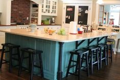 Ah  . . . someday I will have a fantastic turquoise island like this.  I love EVERYTHING about this kitchen...the touch of turquoise, the chalkboard pantry.  Perfection.