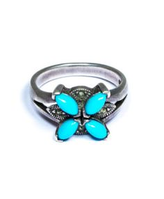 This splendid piece of Turquoise Ring has a unique royal charm. The sophistication of this finger ring makes it a must have artificial jewelry online.
