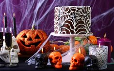 A table decorated for halloween with a spider web cake.