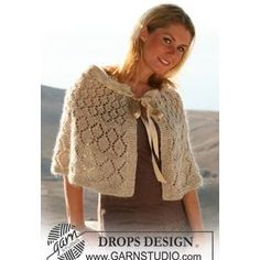 Ladies' Cape Knitting Pattern with Lace Design in DROPS