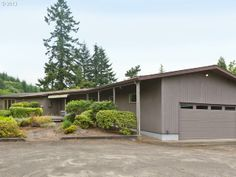 1963 West Linn MCM. Vaulted beamed ceilings, stunning paneling, floating stone fireplace, original open plan kitchen, on 9 acres! $499K.