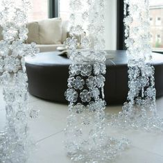 Room screens made out of the bottoms of plastic water bottles. Very clever!