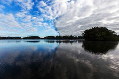 A reflective view of the clouds over the Mere, Ellesmere, Shropshire, UK.