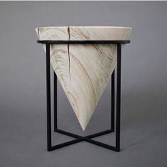 Cut from a solid piece of timber and suspended on a steel frame, The Gravity side table by @toby_jones is edgy yet streamlined, engineered craftsmanship and sculptural art - Just as unique and original, design should be.