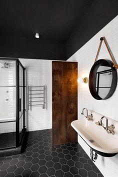 black tile floor. shower frame work. white walls | black ceiling. sink. It is fabulous.