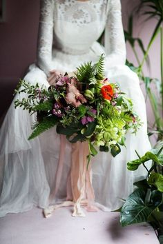 East London Wedding - Green, Purple and Red Foliage Wedding Bouquet - Bride holding bouquet in hand, Helleborus, Poppies, Ferns, Orchids