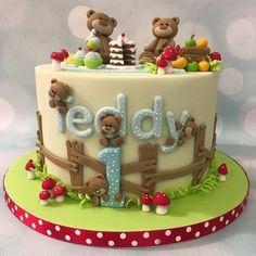 Teddy bear picnic cake birthday celebration with toadstools, cupcakes, fruit, cake