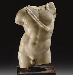 A ROMAN MARBLE TORSO OF APOLLO                                                                                                                                                                       CIRCA 1ST CENTURY B.C.-1ST CENTURY A.D