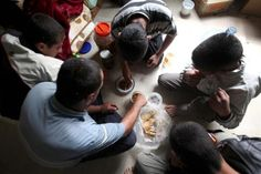 Syrian refugees eat at a mosque at the northern Lebanese border village of Boqaya, near the Lebanese-Syrian border, May 19, 2011.   REUTERS/Mohamed Azakir