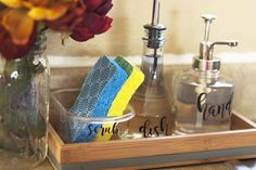 Check out this pretty & organized kitchen sink! Love the idea of a sink-side tra. Check out this pretty & organized kitchen sink! Love the idea of a sink-side tray for organizing dishwashing supplies & those DIY soap dispensers are cute! Kitchen Sink Decor, Kitchen Sink Organization, Sink Organizer, Kitchen Dishes, Organized Kitchen, Kitchen Ideas, Soap Kitchen, Kitchen Design, Kitchen Modern