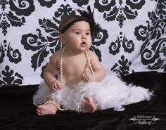 New Year's photo shoot - I know how to pose for the camera. 6 month old Abigail