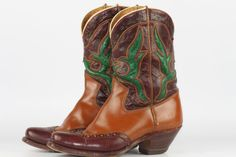 Beautiful vintage Acme wing tip leather cowboy boots with cut outs, circa 1950's.