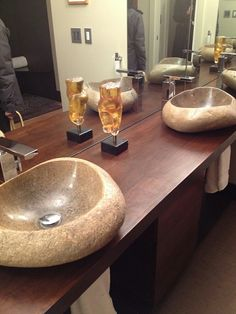 Natural materials in the bathroom, of course! Basins carved out of rock, placed on gorgeous red wood.
