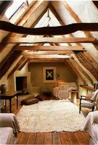 Cob house - love this for master bedroom, cozy, sunshine to wake me up, really love the asymmetrical wood beams. Um, yes please.